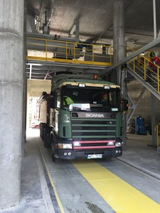 Truck positioned under gypsum loading spout